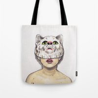 avenger Tote Bags featuring Masked Avenger by Kyreena Hay