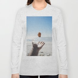 Playing with a seashell on the beach Long Sleeve T-shirt