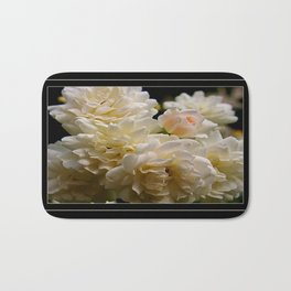 white roses and a light pink bud  Bath Mat