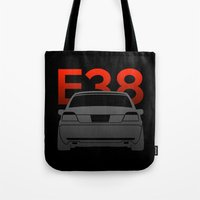 bmw Tote Bags featuring BMW E38 by Vehicle