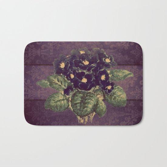 Violettes on vintage purple distressed damask Bath Mat