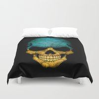 ukraine Duvet Covers featuring Dark Skull with Flag of Ukraine by Jeff Bartels