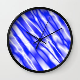 Light metal crooked mirror with blue white diagonal stripes. Wall Clock