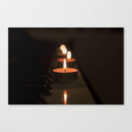 Candles on the piano Canvas Print