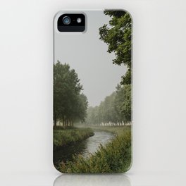The bend of river between trees in misty morning iPhone Case