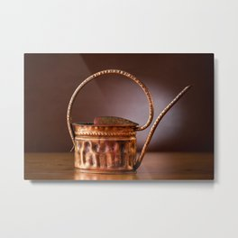vintage brass watering can on table Metal Print