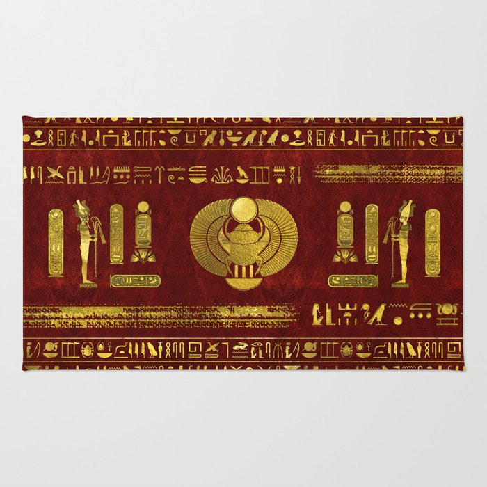 Golden Egyptian Scarab on red leather Rug