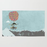 brompton Area & Throw Rugs featuring Riding A Bicycle Through The Mountains by Wyatt Design