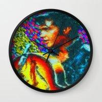 elvis presley Wall Clocks featuring Elvis Presley by Kevin Rogerson
