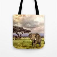 novelty Tote Bags featuring Elephant Landscape Collage by Moody Muse