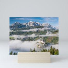 Hohenwerfen Castle in Austria at Foggy morning in Autumnal Season Mini Art Print