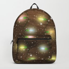 Christmas lights on wooden background Backpack