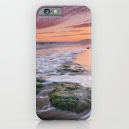 Green rocks. Sunset at the beach iPhone Case
