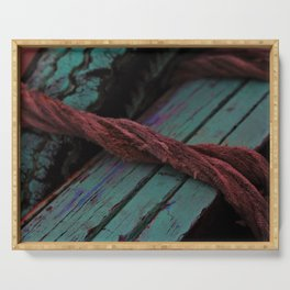 Red rope wrapped around wooden boat used on the river Ganges Serving Tray