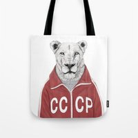 soviet Tote Bags featuring Soviet lion by Balazs Solti