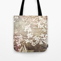 returns Tote Bags featuring warmth returns by inourgardentoo