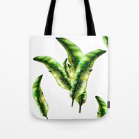 banana leaf Tote Bags featuring Banana Leaf -watercolor  by craftberrybush