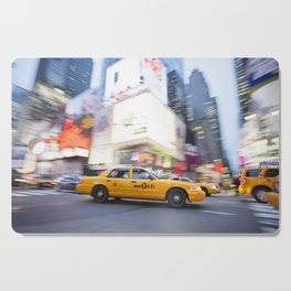 Yellow taxi cab in times square Cutting Board