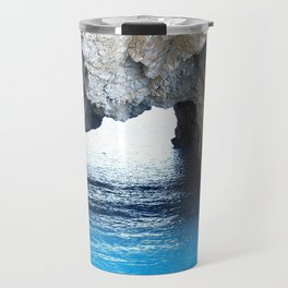 Rocks created a natural arch over crystal blue water Travel Mug