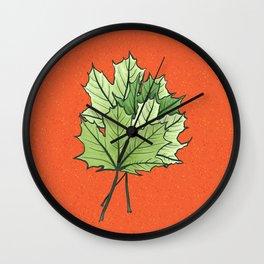 Green Maple Leaves On Vibrant Orange Wall Clock