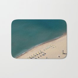 Aerial view of beach with umbrellas and beds in Greece  Bath Mat
