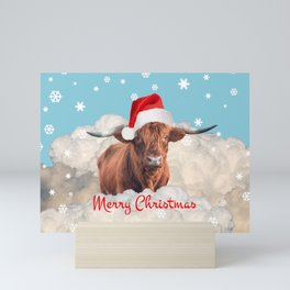 Highland Cow Santa Claus Merry Christmas snow Clouds Mini Art Print