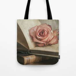 Still life with pink rose and old books Tote Bag