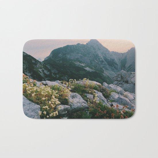 Mountain flowers at sunrise Bath Mat