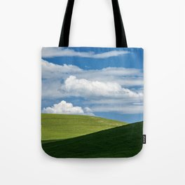 White clouds above green hills Tote Bag