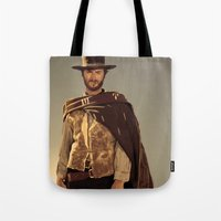 clint eastwood Tote Bags featuring Clint Eastwood by Thousand Lines Ink