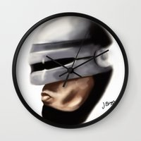 robocop Wall Clocks featuring Robocop. by Jamie Briggs
