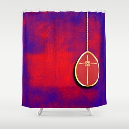 Gold cross in red egg hanging against a rich red and purple Shower Curtain