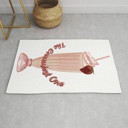 Glass of creamy strawberry milkshake with a straw Rug
