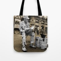 newspaper Tote Bags featuring Newspaper Man by Rob Hawkins Photography
