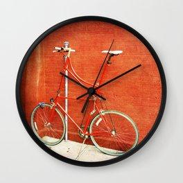 Red Tall Bike Against Brick Wall Wall Clock