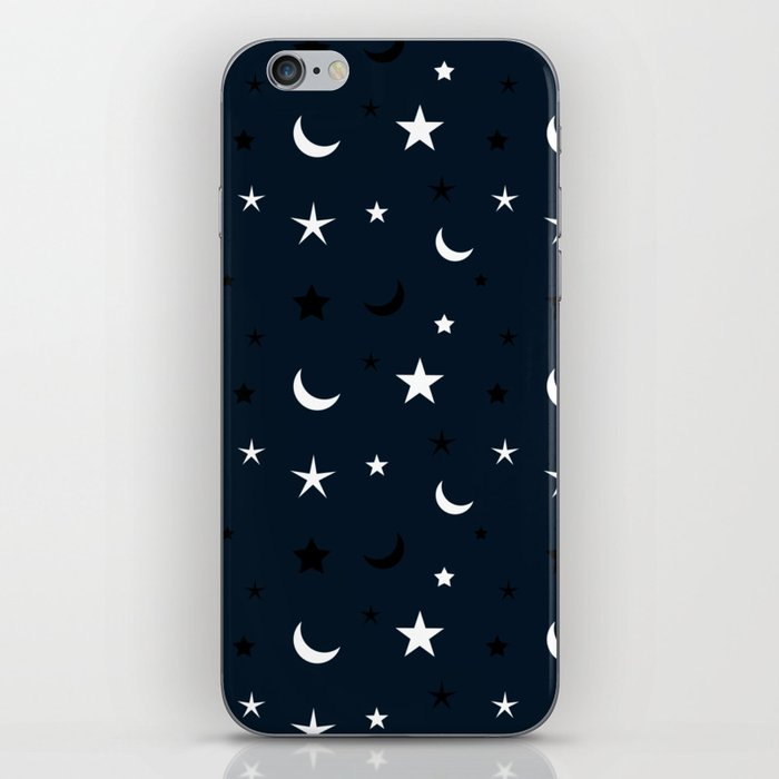 Navy blue background with black and white moon and star pattern iPhone Skin
