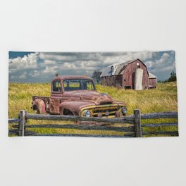 Pickup Truck behind wooden fence in a Rural Landscape Beach Towel