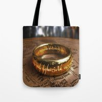 lord of the ring Tote Bags featuring RING by aztosaha