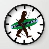 bigfoot Wall Clocks featuring Sasquatch Squatchin' Surfing Bigfoot by mailboxdisco