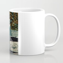 the first man under a tree Coffee Mug