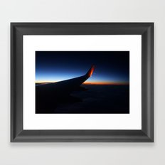 Flying over the west coast at sunset Framed Art Print