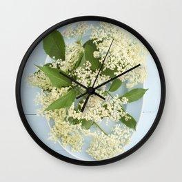 Elderflowers on a blue plate Wall Clock