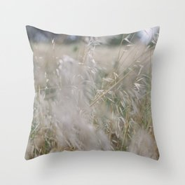 Tall wild grass growing in a meadow Throw Pillow