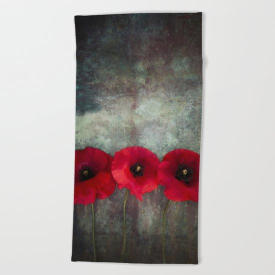 Three red poppies Beach Towel