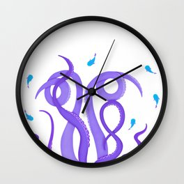 Violet tentacles of octopus among turquoise fish Wall Clock