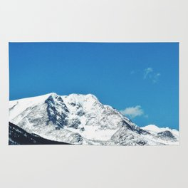 bold mountain against the sky Rug