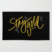 stay gold Area & Throw Rugs featuring Stay Gold by Chelsea Herrick