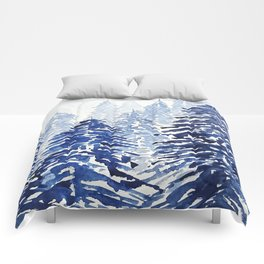 A snowy pine forest Comforters