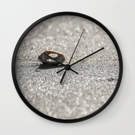 Sun Reflected in a Shell on a Sparkling Sandy Beach Wall Clock