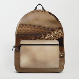 Snake reflection in water puddle Backpack